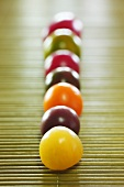 Tomatoes of various colours in a row