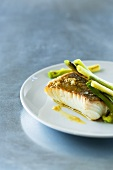 Fish fillet with garlic butter and spring onions
