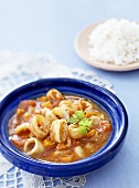Seafood and tomato stew with rice
