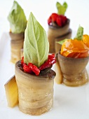 Aubergine rolls filled with peppers