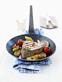 Tuna fillet with vegetables in frying pan