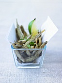 Anchovies with lime in glass dish