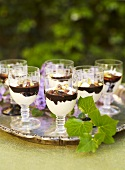 Glasses of chocolate coconut mousse with rum & pistachios