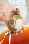 Child dyeing Easter egg