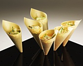 Paper cones filled with sprout salad