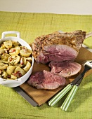 Roast leg of lamb with potatoes and bacon