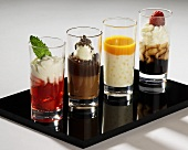Various desserts in glasses