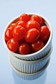 Small plum tomatoes in stacked ramekins