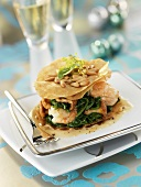 Tower of puff pastry, spinach and langostinos