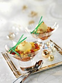 Fruit salad with ice cream and ginger and coconut sprinkles