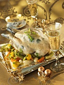Guinea fowl with herb stuffing on a bed of vegetables