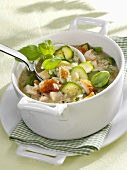 Chicken and rice stew with courgettes and basil