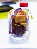 Home-made potato crisps in a glass