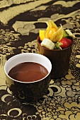 Chocolate fondue with mixed fruit