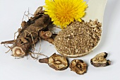 Whole and ground dandelion root with flower
