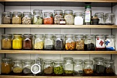 Spices in preserving jars on shelves