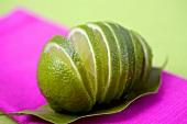 Sliced lime on a lime leaf