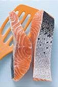 Pieces of raw salmon with orange spatula