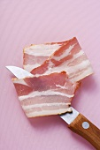 Rasher of bacon and kitchen knife
