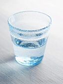 Pale blue glass of water