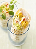 Turkey and vegetable wraps in two glasses