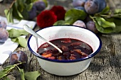 Home-made plum compote in a bowl