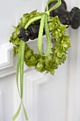 Small hop wreath on a door handle