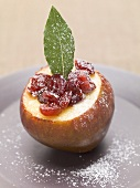 Pear with cranberries, icing sugar and bay leaf