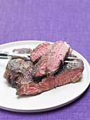 Beefsteak on plate with meat fork