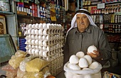 Vendor selling jameed (dry, salted goat's milk yoghurt, Jordan)