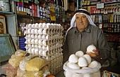 Vendor selling jameed (dry, salted goat's milk yoghurt, Jordan)