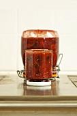 Jars of tomato & blackberry chutney standing upside down