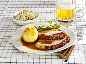 Roast pork with potato dumpling, cabbage salad and beer
