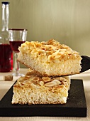Two pieces of butter cake with flaked almonds