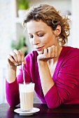 Woman drinking caffe latte
