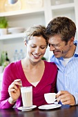 Courting couple drinking coffee
