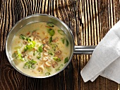 Potato soup with spring onions and herbs