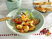 Scampi in garlic butter, baguette slices