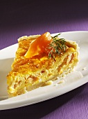 A piece of quiche with smoked salmon