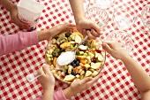 Putting sugar on fruit salad