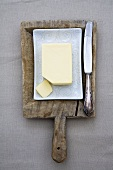 Butter in a butter dish with knife