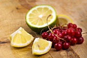 Redcurrants, lemon wedges and half a lime