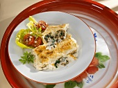 Baked cannelloni with meat and spinach filling