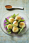 Fruit dumplings with cinnamon and fresh mint