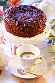 Festive chocolate gateau and a cup of coffee