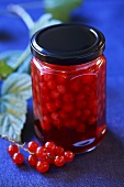 Redcurrent compote in a jar