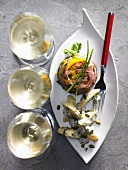 Ham and vegetables in aspic and three glasses of white wine