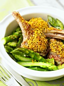 Lamb chops with orange and chilli crust on green asparagus