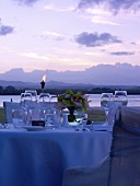 Laid table on Mauritius at twilight