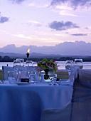 Laid table on Mauritius at twilight